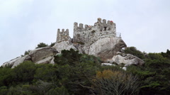 Tourists on top of Castle of the Moors wall tower, Sintra, Portugal Stock Footage