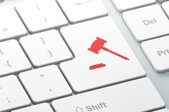 Law concept: Gavel on computer keyboard background - stock illustration