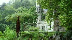 Church chapel in lush forest gardens, Quinta da Regaleira estate, Sintra Stock Footage