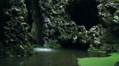Waterfall, green murky pond, Quinta da Regaleira, close up, Sintra, Portugal Stock Footage