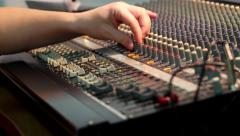 Hand working with sound mixer control audio, moving faders and regulators - stock footage