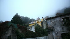Yellow house in small mountain town, spooky fog, Sintra, Portugal Stock Footage