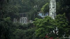 Quinta da Regaleira estate, lush green foggy forest garden, tilt up, Sintra Stock Footage