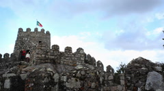Portugal flag, camera crew, Castle of the Moors fortress wall, Sintra Stock Footage