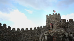 Portuguese flag, tourists, Castle of the Moors fortress wall, Sintra, Portugal Stock Footage