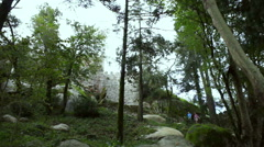 Tourists walk, Castle of the Moors fortress wall, pan left, Sintra, Portugal Stock Footage