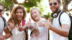 Smiling hipster friends showing thumbs up Stock Footage