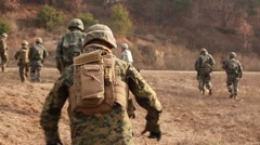 South KOREA, DECEMBER 2015, Soldiers Run Walk Over Open Field Stock Footage