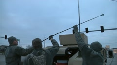 MISSOURI USA, DECEMBER 2015, Soldier Open Car Trunk Of HUMVEE Arkistovideo