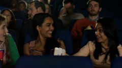 4K Happy young female friends watching a film in movie theatre Stock Footage