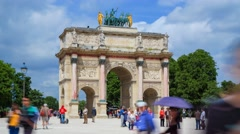 Tourists in front of the Arc de Triomphe du Carrousel in Paris Stock Footage