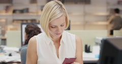 Powerful Businesswoman executive working at computer using smart phone connected Stock Footage