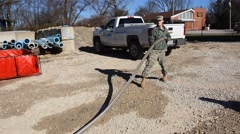Stock Video Footage of MISSOURI USA, JANUAR 2016, US Soldier Pull Water Pipe To Reservoir Missouri