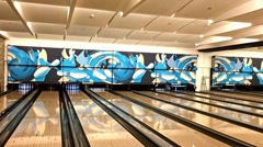 People Playing Bowling Game On Local Bowling Entertainment Club Stock Footage