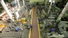 Flying over production line in industrial factory Stock Footage
