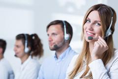 Woman doing career in telemarketing - stock photo