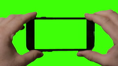 Holding phone vertically with green screen Stock Footage