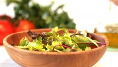 Balsamic vinegar dressing being poured over healthy salad food - stock footage