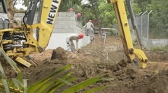 TRUJILLO HONDURAS, JANUAR 2016, US Soldiers Build House Honduras Digger Stock Footage