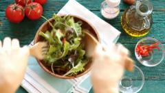 Fresh mixed vegetables falling into bowl of salad . Slow motion - stock footage