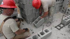 TRUJILLO HONDURAS, JANUAR 2016, Two US Soldiers Adjust Stone For building Wall Stock Footage