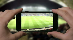 Man shooting video at football game - stock footage