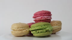 Colorful Macaroons rotating on a white background Stock Footage