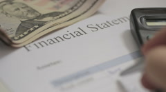 Writing A Financial Statement Stock Footage