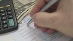 Man Filling Out An Tax Return Application Form - stock footage