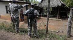TRUJILLO HONDURAS, JANUAR 2016, US Soldiers Talk Civilian Stock Footage