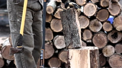 Wood Splitting Multiple Hits with the axe, chopping firewood Stock Footage