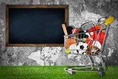 Sports equipment shopping cart stone wall Stock Photos