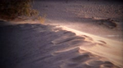 1972: Dust blowing off top of sanddune on windy sunny day. Stock Footage