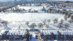 Aerial View of Patterson Park Covered in Snow - Baltimore MD Stock Footage