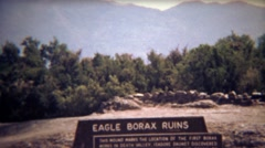 1972: Eagle borax ruins abandoned site in summer sunshine. Stock Footage