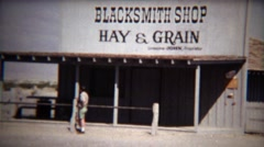 1972: Old time abandoned blacksmith shop selling hay and grain. Stock Footage