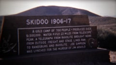 1972: Ski Doo ghost town abandoned gold mining camp from early 1900s. - stock footage