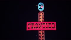 1972: Frontier hotel casino neon sign at night downtown bright lights. - stock footage