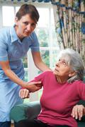 Care Worker Mistreating Elderly Woman - stock photo