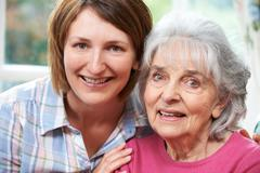 Stock Photo of Portrait Of Senior Mother And Adult Daughter