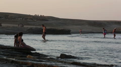people spend time near the sea in the evening, red sea - stock footage