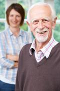 Senior Man With Adult Daughter At Home - stock photo