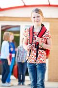 Girl Standing Outside School With Rucksack Stock Photos