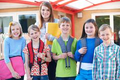 Portrait Of School Pupils Outside Classroom With Teacher Stock Photos
