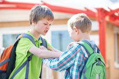 Two Boys Fighting In School Playground Stock Photos