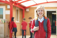 Girl Wearing Uniform Standing In School Playground Stock Photos