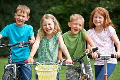 Group Of Children Playing On Bikes And Scooter Stock Photos