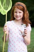 Girl With Net And Butterfly In Jar - stock photo