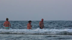 Russian people spend time in the sea in the evening, red sea - stock footage