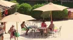 People sit under an umbrella near the bar in the hotel Stock Footage